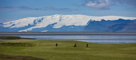 Golfers at Hornafjordur fjord, Iceland.