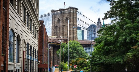 Manhattan Bridge looms over the historic neighborhood of Dumbo, in Brooklyn
