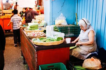 A vendor preparing cactus paddles at Mercado de la Merced, Mexico City.