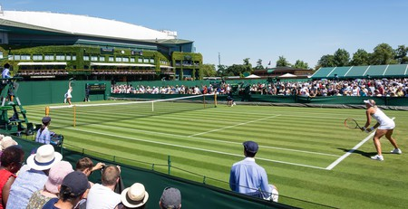 Woman's match on outside court 8 at The Championships 2018, Wimbledon
