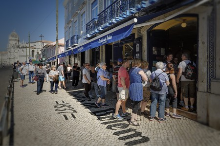 People queue outside Pasteis de Belem in Lisbon