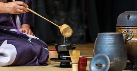 A woman demonstrates a Japanese tea ceremony
