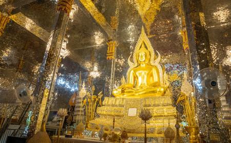 Golden Buddha statue inside Wat Chantaram (Wat thasung) temple.