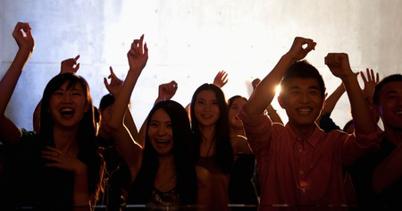 People dance in a nightclub in Beijing, China