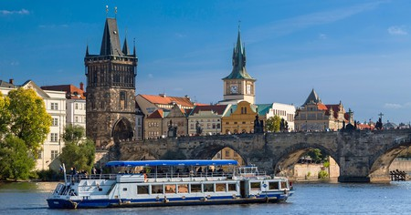 A boat stays afloat on the Vltava River in Prague