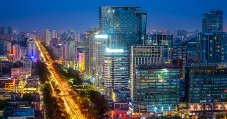Downtown cityscape at night in Chaoyang District, Beijing, China