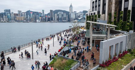 People walk up and down the Hong Kong Avenue of Stars at Tsim Sha Tsui's Victoria Harbour