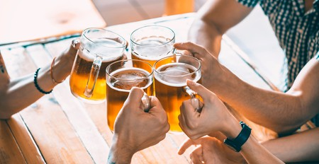 Group of friends drinking beer in a bar