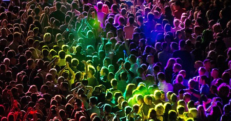 Rainbow colours wash over the crowd during a performance by All Saints at Manchester Pride in 2014