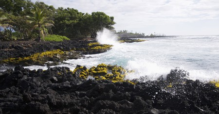Waves crash ashore at Isaac Hale Park on the island of Hawaii
