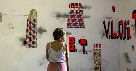 A woman looks at the artwork 'Black Hill' by artist Barry McGee.