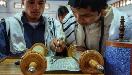 Bnei Menashe Jewish men read from the Torah