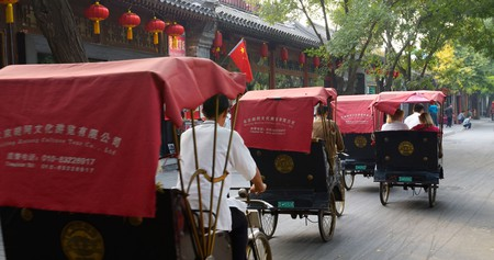 Pedicabs travel down the street in Shichahai, Beijing, China
