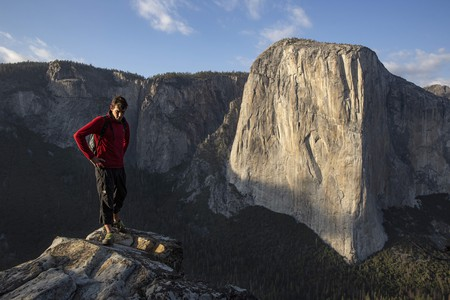 Alex Honnold stands with El Capitan in the background