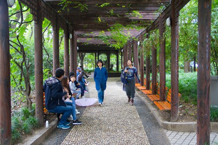 People walk through Huangpu Park near the Bund in Shanghai.