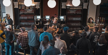 Customers lined up at a bar in Los Angeles, California.