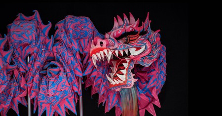 A traditional Chinese dragon made of fabric rest against backstage wall before the International Chinese New Year Night Parade in Hong Kong,