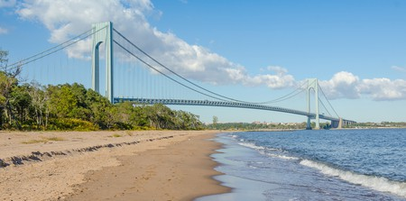 The Verrazzano-Narrows Bridge rises behind Staten Island Beach