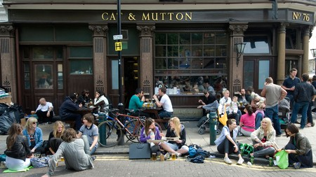 Drinkers in the sun outside the Cat and Mutton, Hackney