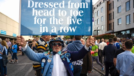 A Dublin Gaelic football fan waves a flag with messages in support of the team, outside Croke Park stadium on the day of the All-Ireland finals on September 14, 2019