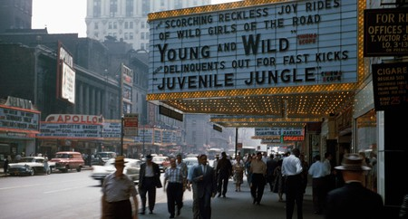 People pass by a theater showing 'Young and Wild' in New York in 1958