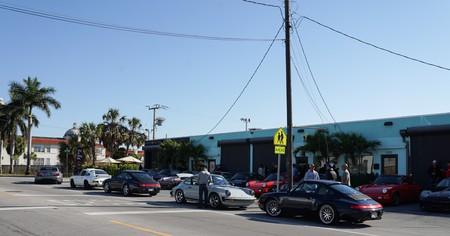 Porsches await their drivers outside Imperial Moto Café
