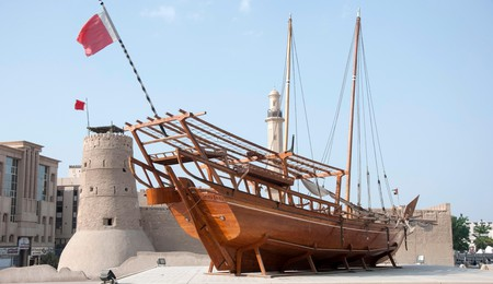 The Dubai Museum features a traditional wooden dhow outside