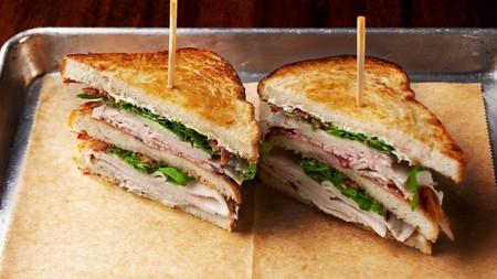 Cuban sandwich with roasted pork, honey ham and sweet cherry jam