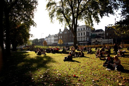 A Sunday crowd enjoys the late afternoon sun on Islington Green