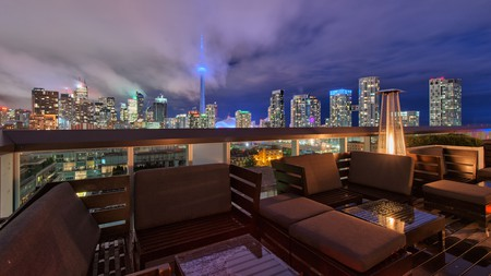 The Toronto skyline at dusk can be viewed from the terrace of the Thompson hotel