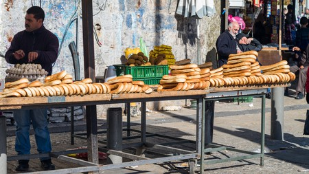 A street vendor sells food in a market in the Old City of Jerusalem
