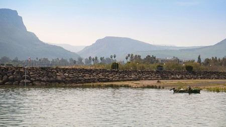 A fisherman fishing at the Sea of Galilee