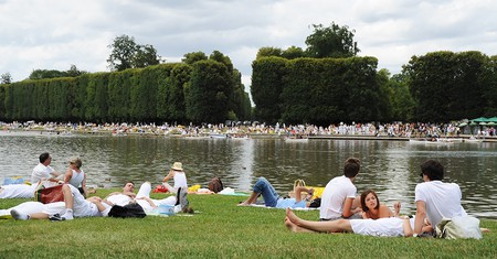 French people lounge under a cloudy Bastille Day sky