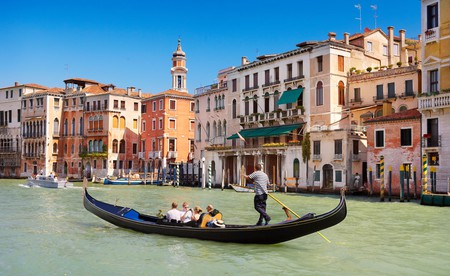 A gondola ferries tourists along the magnificent Grand Canal in Venice