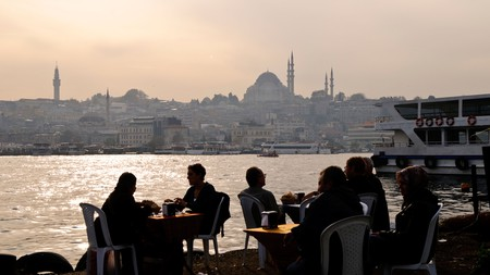 Diners at a fish restaurant next to the Karakoy Fish Market in Istanbul near the Galata Bridge