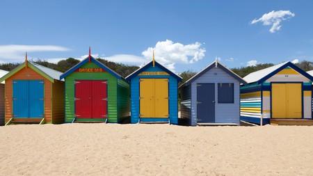 Painted beach huts adorn Brighton Beach