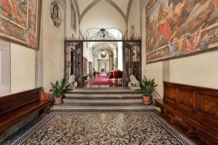 A grand entrance welcomes guests to Palazzo Magnani Feroni