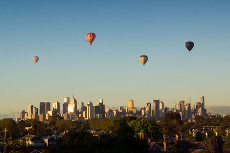 Hot air balloons fly over Melbourne
