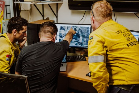 Cape Town Volunteer Firefighters analyse maps at their base