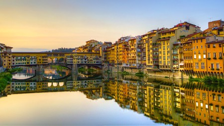 The early morning light illuminates Florence's Ponte Vecchio