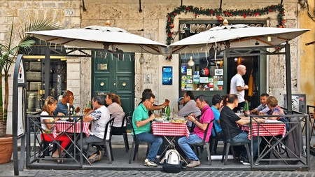 Diners enjoy an al fresco meal on the historic streets of Rome