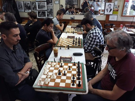 Men play chess at Kafeneio Panellinion in Athens