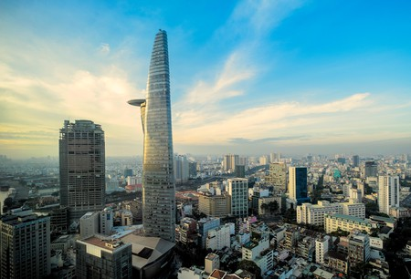 Saigon One (seen here behind The Bitexco Tower) in Ho Chi Minh City, Vietnam, has been standing incomplete since construction began in the mid-2000s