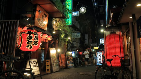 Step off the main streets into the back alleys - this is where you'll find some of the tastiest dishes in Osaka.
