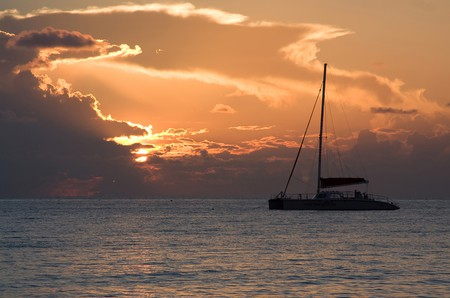 Watch the sun set on a relaxing catamaran cruise off Seven Mile Beach |