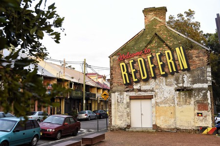 The 'Welcome to Redfern' mural is arguably the most well-known example of public Indigenous art in the neighbourhood.