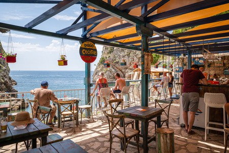 Beach Bar Dodo is carved into a stone cliff