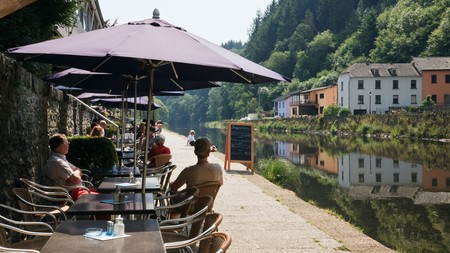 Tables outside the riverside cafe beside the River Our, Grand Duchy of Luxembourg