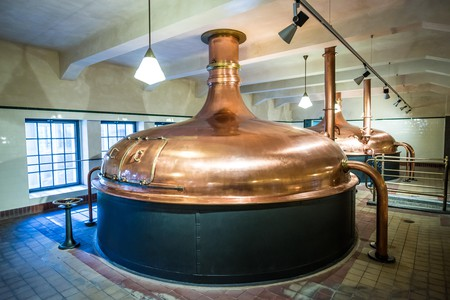 Copper brewing tank in old brewhouse in Pilsner Urquell Brewery in Pilsen city, Czech Republic