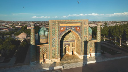 Uzbekistan architecture is characterised by vibrant mosaics such as these at the Sher-Dor Madrasah